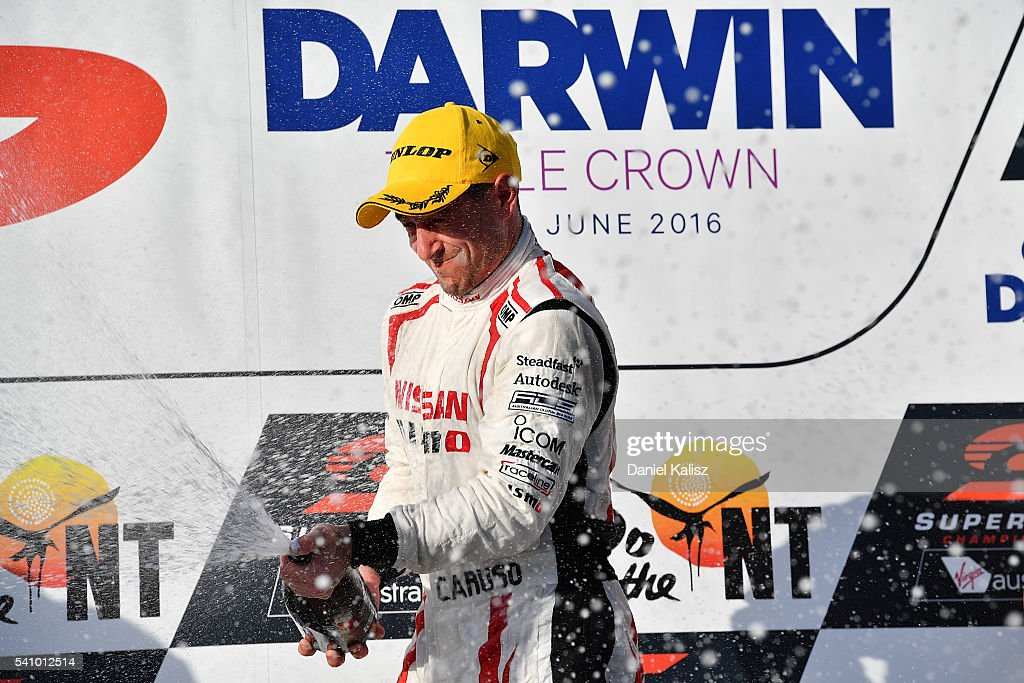 Michael Caruso driver of the Nissan Motorsport Nissan Altima celebrates on the podium after winning race 1 for the V8 Supercars Darwin Triple Crown...
