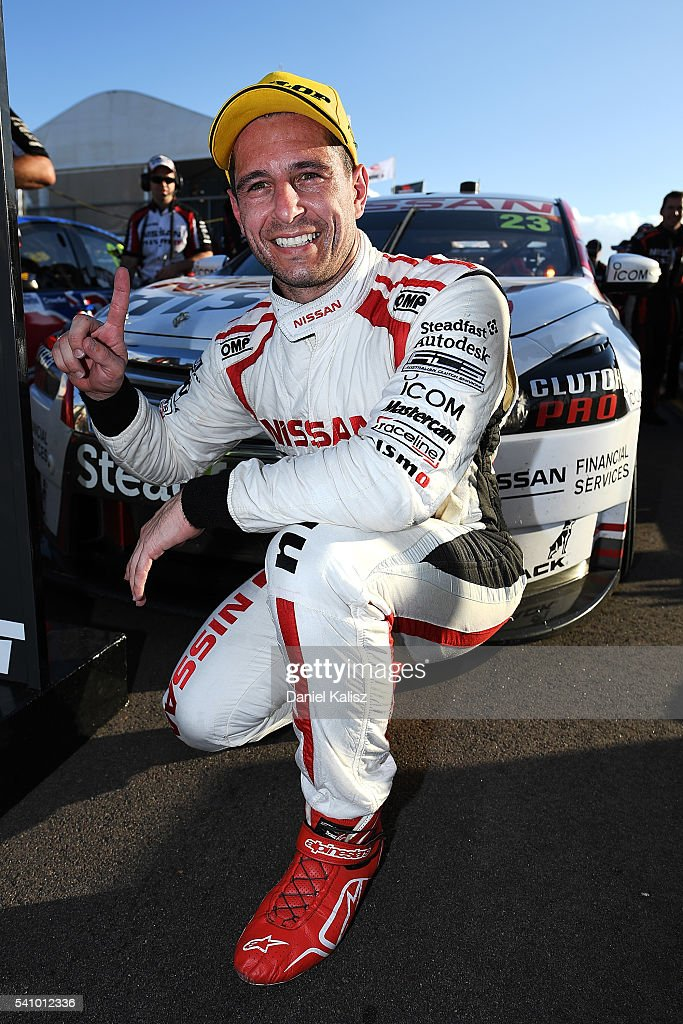 Michael Caruso driver of the Nissan Motorsport Nissan Altima reacts after winning race 1 of the V8 Supercars Darwin Triple Crown at Hidden Valley...