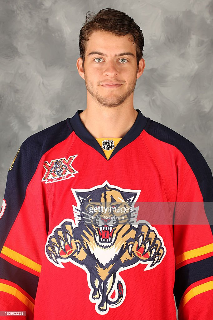 Michael Caruso of the Florida Panthers poses for his official headshot for the 2013-2014 NHL season on September 11, 2013 in Sunrise, Florida.