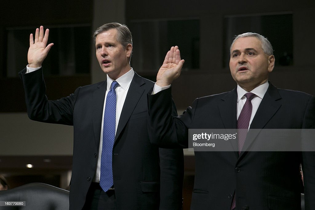 Michael Cavanagh, co-chief executive officer of corporate and investment bank with JPMorgan Chase & Co., left, and Douglas Braunstein, vice chairman of JPMorgan Chase & Co., swear into a Senate Permanent Subcommittee on Investigations hearing in Washington, D.C., U.S., on Friday, March 15, 2013. JPMorgan Chase, the biggest U.S. bank by assets, compensated chief investment office traders in a way that encouraged risk-taking before the unit amassed losses exceeding $6.2 billion, a Senate committee said. Photographer: Andrew Harrer/Bloomberg via Getty Images