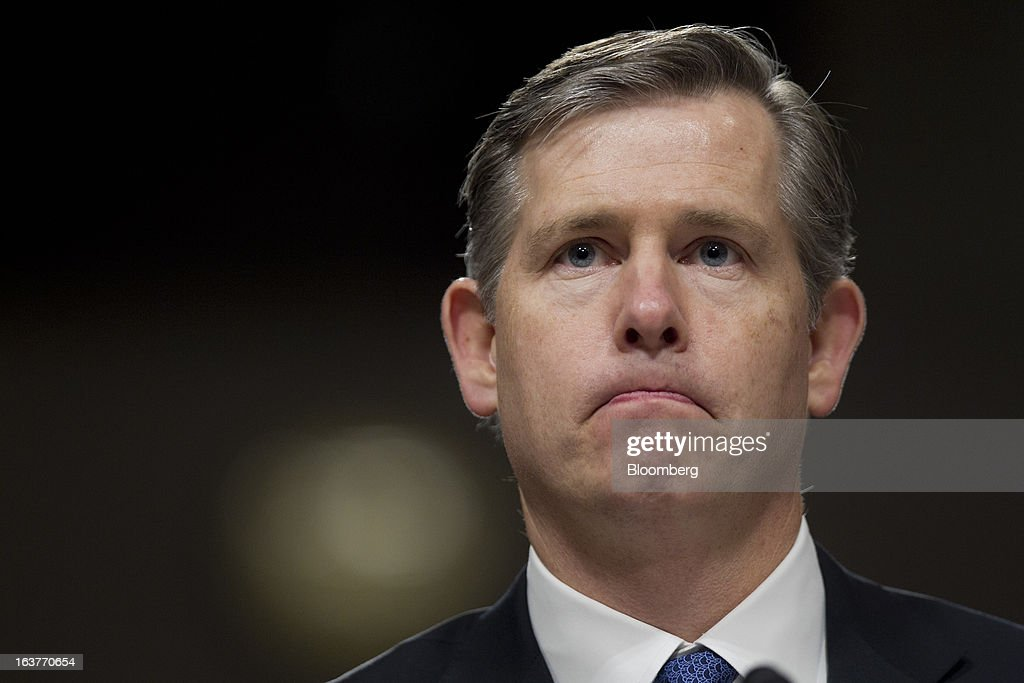 Michael Cavanagh, co-chief executive officer of corporate and investment bank with JPMorgan Chase & Co., listens during a Senate Permanent Subcommittee on Investigations hearing in Washington, D.C., U.S., on Friday, March 15, 2013. JPMorgan Chase, the biggest U.S. bank by assets, compensated chief investment office traders in a way that encouraged risk-taking before the unit amassed losses exceeding $6.2 billion, a Senate committee said. Photographer: Andrew Harrer/Bloomberg via Getty Images