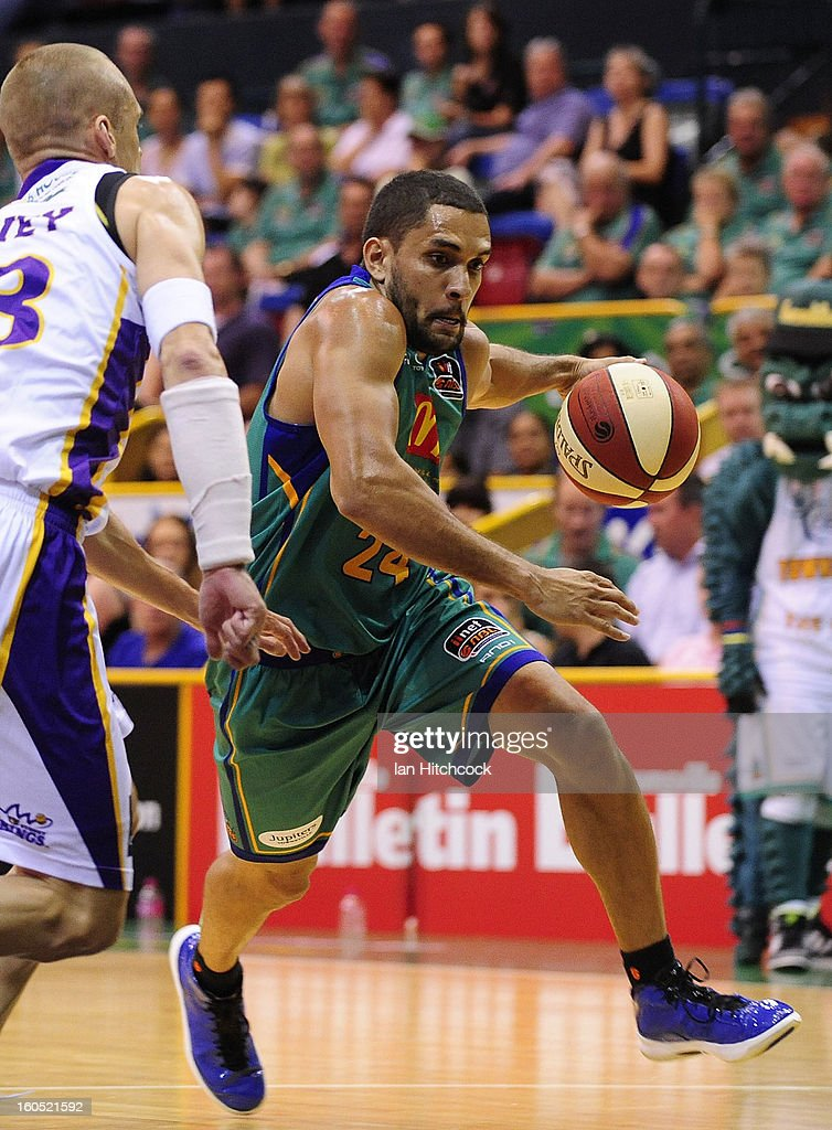 Michael Cedar of the Crocodiles attempts to drive past James Harvey of the Kings during the round 17 NBL match between the Townsville Crodcodiles and the Sydney Kings at Townsville Entertainment Centre on February 2, 2013 in Townsville, Australia.