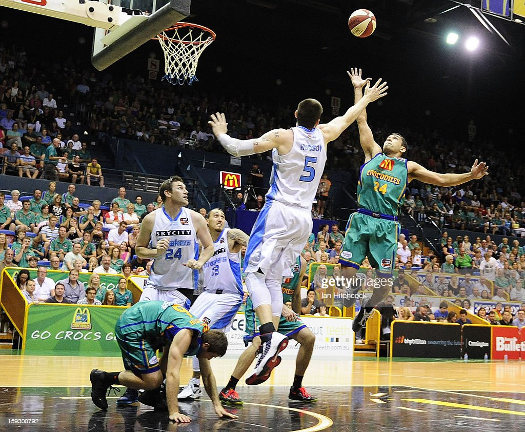 Michael Cedar of the Crocodiles contests the ball with Will Hudson of the Breakers s during the round 14 NBL match between the Townsville Crocodiles and the New Zealand Breakers at Townsville Entertainment Centre on January 11, 2013 in Townsville, Australia.