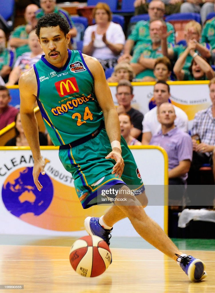 Michael Cedar of the Crocodiles dribbles the ball during the round eight NBL match between the Townsville Crocodiles and the Perth Wildcats at Townsville Entertainment Centre on November 24, 2012 in Townsville, Australia.