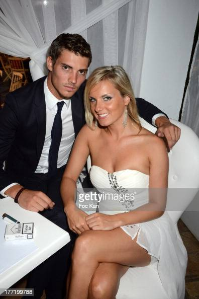 Michael Champion and actress Emmanuelle Zimmerman attend the Massimo Gargia's Birthday Dinner at Moulins de Ramatuelle on August 21 2013 in Saint...