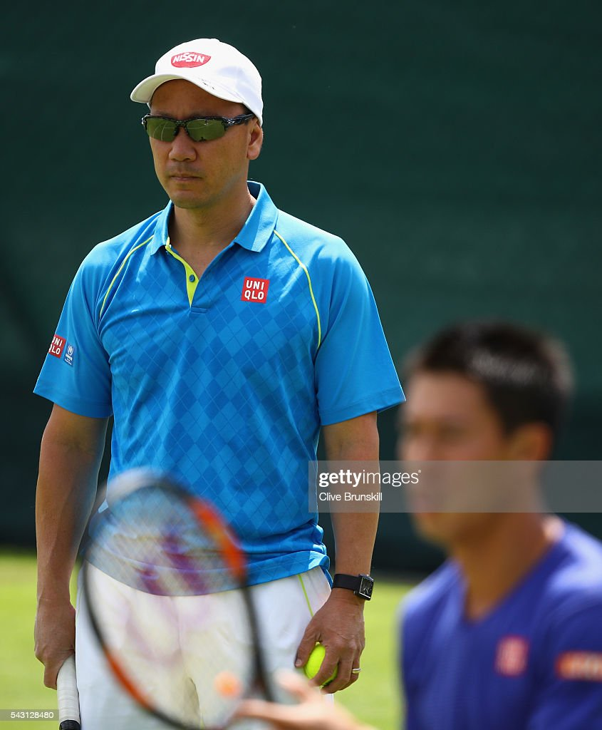 <a gi-track='captionPersonalityLinkClicked' href=/galleries/search?phrase=Michael+Chang&family=editorial&specificpeople=206264 ng-click='$event.stopPropagation()'>Michael Chang</a> coach of <a gi-track='captionPersonalityLinkClicked' href=/galleries/search?phrase=Kei+Nishikori&family=editorial&specificpeople=4432498 ng-click='$event.stopPropagation()'>Kei Nishikori</a> of Japan watches him in action during a practice session prior to the Wimbledon Lawn Tennis Championships at the All England Lawn Tennis and Croquet Club on June 26, 2016 in London, England.