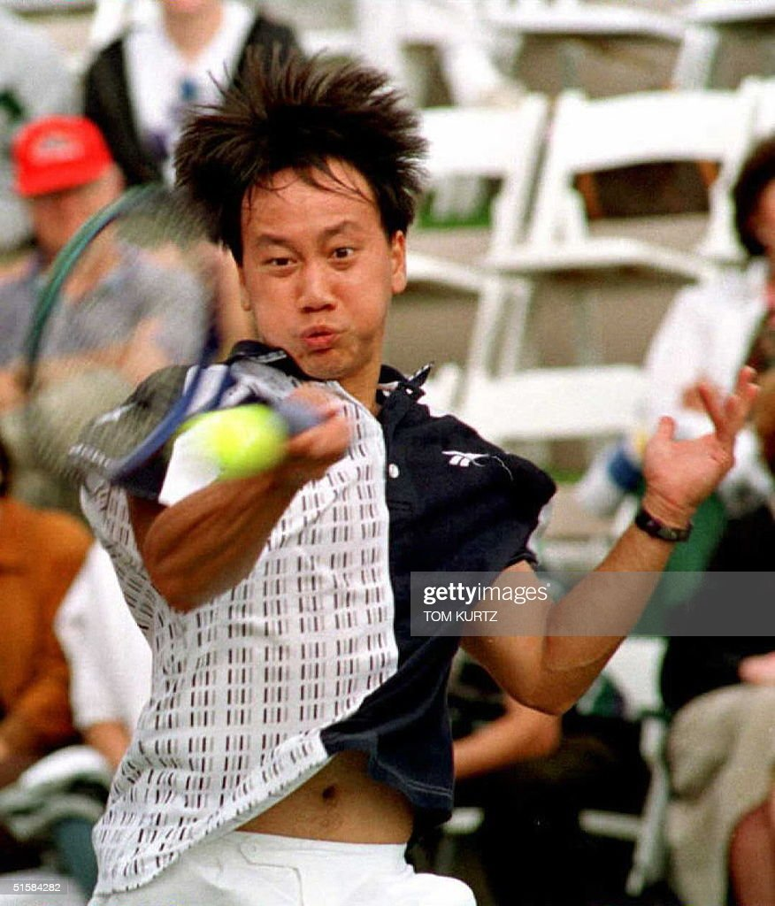 Michael Chang from the United States returns a for