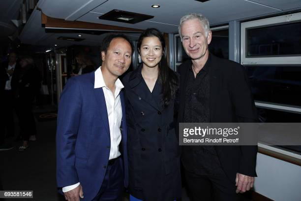 Michael Chang his wife Amber Liu and John McEnroe attend 'Trophee des Legendes' Dinner at Le Paquebot on June 7 2017 in Paris France