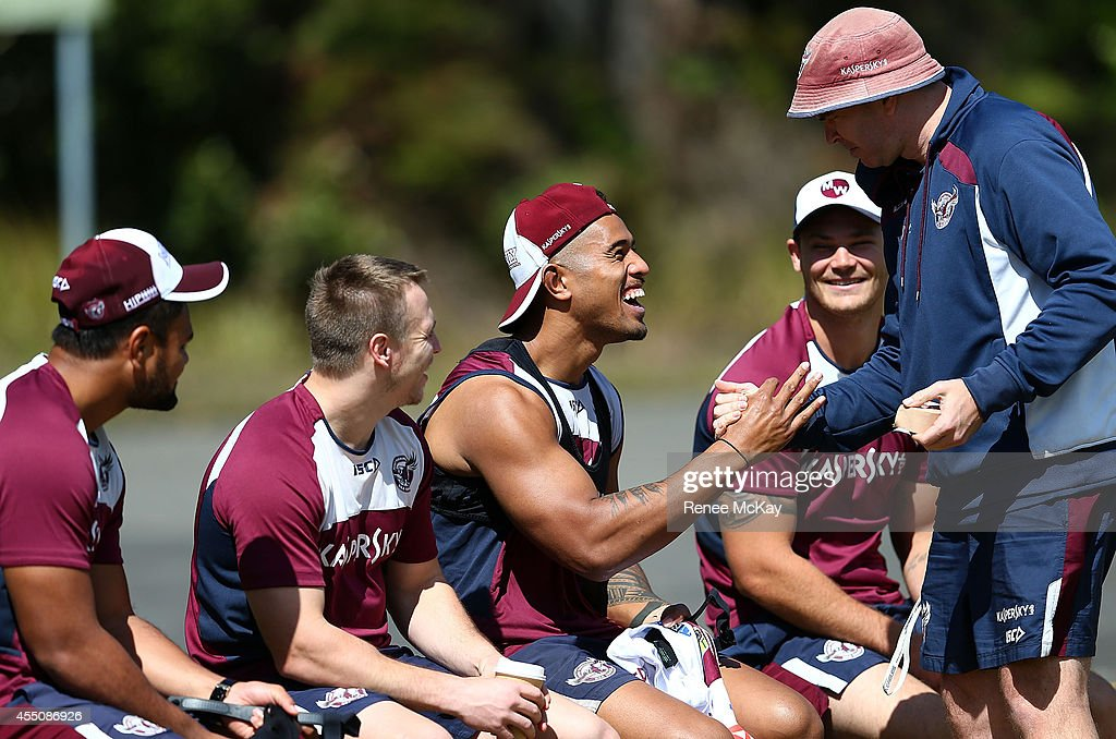Michael Chee Kam is handed a playing jumper during a Manly Sea Eagles NRL training session at the Sydney Academy of Sport on September 10, 2014 in Penrith, Australia.