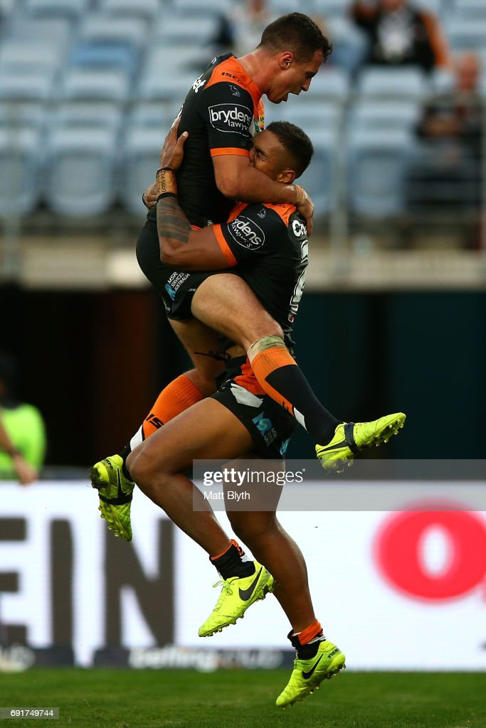 Michael Chee Kam of the Tigers celebrates scoring a try during the round 13 NRL match between the St George Illawarra Dragons and the Wests Tigers at ANZ Stadium on June 3, 2017 in Sydney, Australia.