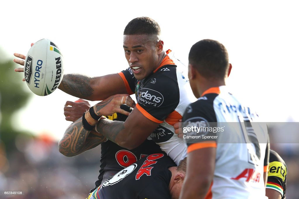 Michael Chee Kam of the Tigers is tackled during the round two NRL match between the Wests Tigers and the Penrith Panthers at Campbelltown Sports Stadium on March 12, 2017 in Sydney, Australia.