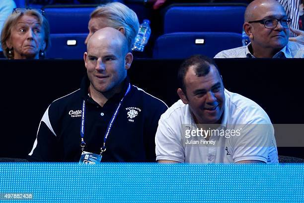 Michael Cheika and Stephen Moore watch on during the match between Roger Federer of Switzerland and Kei Nishikori of Japan on day five of the...