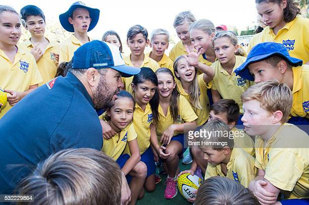 Michael Cheika interacts with school kids during an ARU Game On event at Bronte Public School on May 19 2016 in Sydney Australia