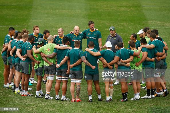 Michael Cheika talks to players during the Australian Wallabies captain's run at Ballymore Stadium on September 9 2016 in Brisbane Australia