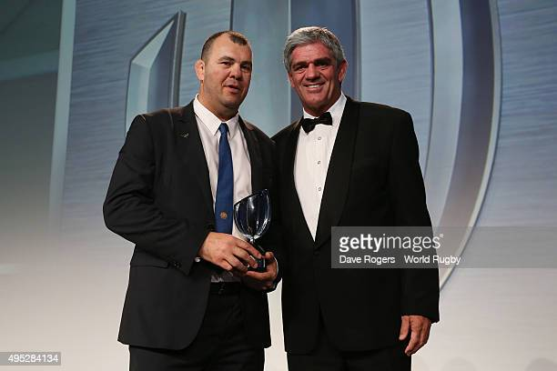 Michael Cheika the coach of Australia receives the World Rugby Coach of the Year award from Mick Mallett during the World Rugby Awards 2015 at...