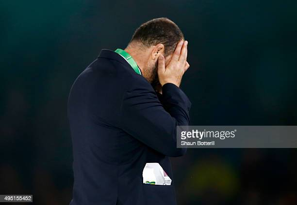 Michael Cheika the head coach of Australia holds his head in his hands following defeat in the 2015 Rugby World Cup Final match between New Zealand...