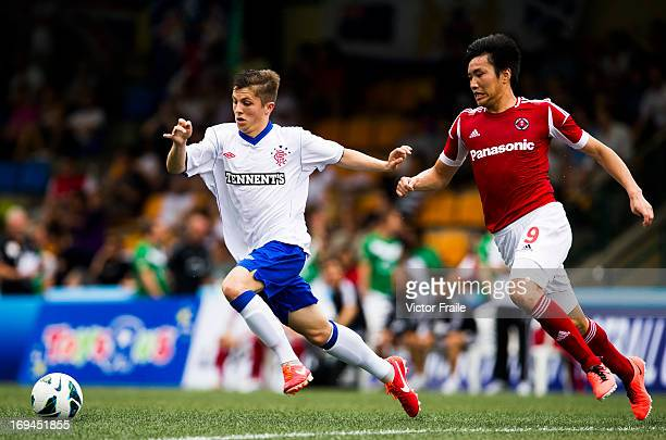 Michael Cheng Lai Hin of South China and Charlie Telfer of Rangers fight for the ball on day two of the Hong Kong International Soccer Sevens at Hong...