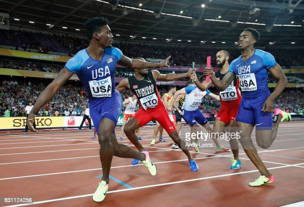 Michael Cherry of United States passes the baton to Fred Kerley in the Men's 4x400 Metres Relay final during day ten of the 16th IAAF World Athletics...