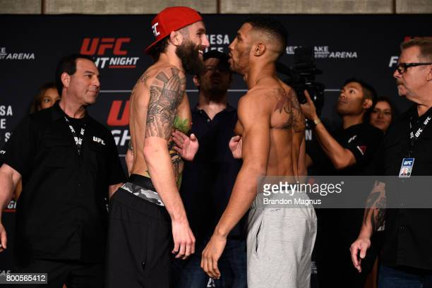 Michael Chiesa and Kevin Lee face off during the UFC Fight Night weighin on June 24 2017 in Oklahoma City Oklahoma