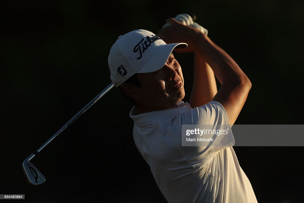 Michael Choi of Australia hits his approach shot on the 18th hole during day two of the 2017 Fiji International at Natadola Bay Championship Golf Course on August 18, 2017 in Suva, Fiji.