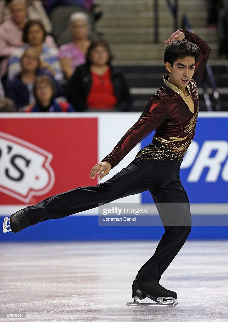 Michael Christian Martinez competes in the Men Short Program during the 2014 Hilton HHonors Skate America competition at the Sears Centre Arena on...