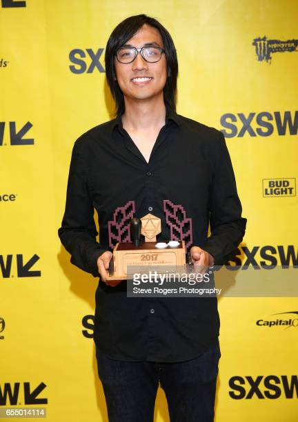 Michael Chu poses with the award for 'Excellence in Multiplayer' for 'Overwatch' at the Gaming Awards Ceremony during 2017 SXSW Conference and...