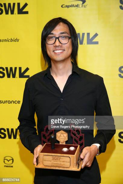 Michael Chu poses with the award for 'Trending Game of the Year' for 'Overwatch' at the Gaming Awards Ceremony during 2017 SXSW Conference and...