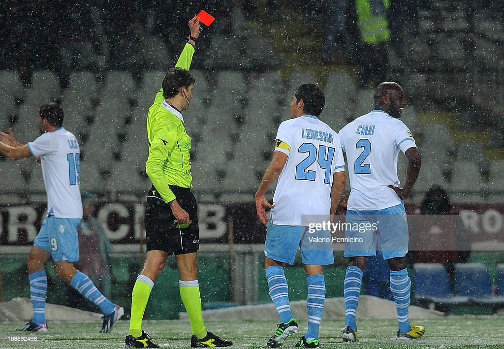 Michael Ciani (R) of S.S. Lazio receives the red card from referee Paolo Tagliavento during the Serie A match between Torino FC and S.S. Lazio at Stadio Olimpico di Torino on March 17, 2013 in Turin, Italy.