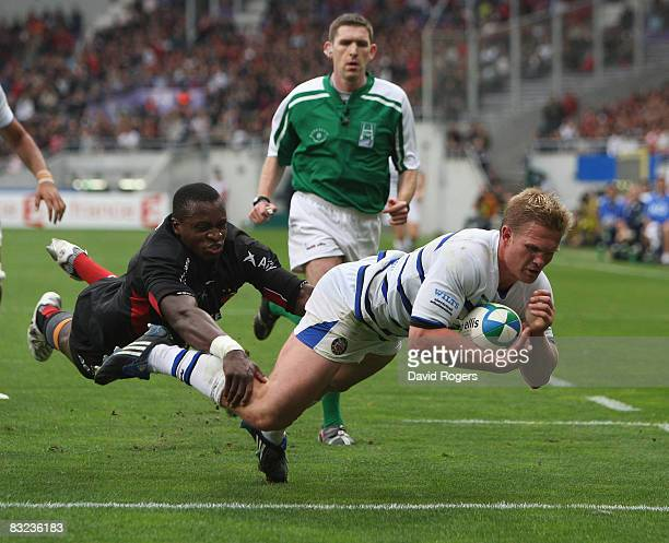 Michael Claassens of Bath dives over to score the first try during the Heineken Cup match between Toulouse and Bath at Stade Toulousain on October 12...
