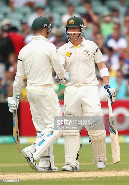Michael Clarke and Brad Haddin of Australia shake hands after making a 100 run partnership during day two of the Second Ashes Test Match between...