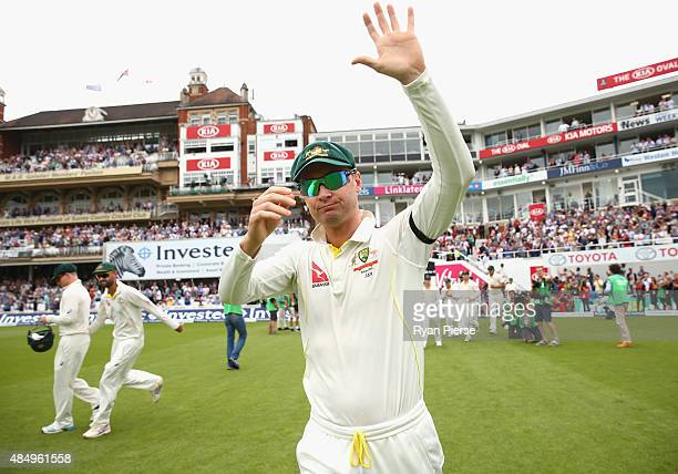 Michael Clarke and Chris Rogers of Australia walk onto the ground during their final test match during day four of the 5th Investec Ashes Test match...