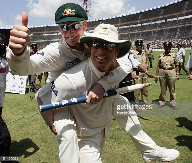 Michael Clarke and Shane Warne of Australia leave the field celebrating after day five of the First Test between India and Australia played at the...