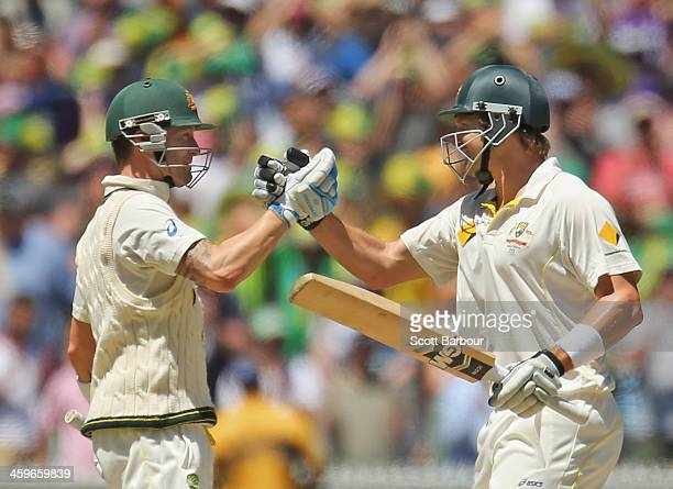 Michael Clarke and Shane Watson of Australia embrace as Australia win the match during day four of the Fourth Ashes Test Match between Australia and...