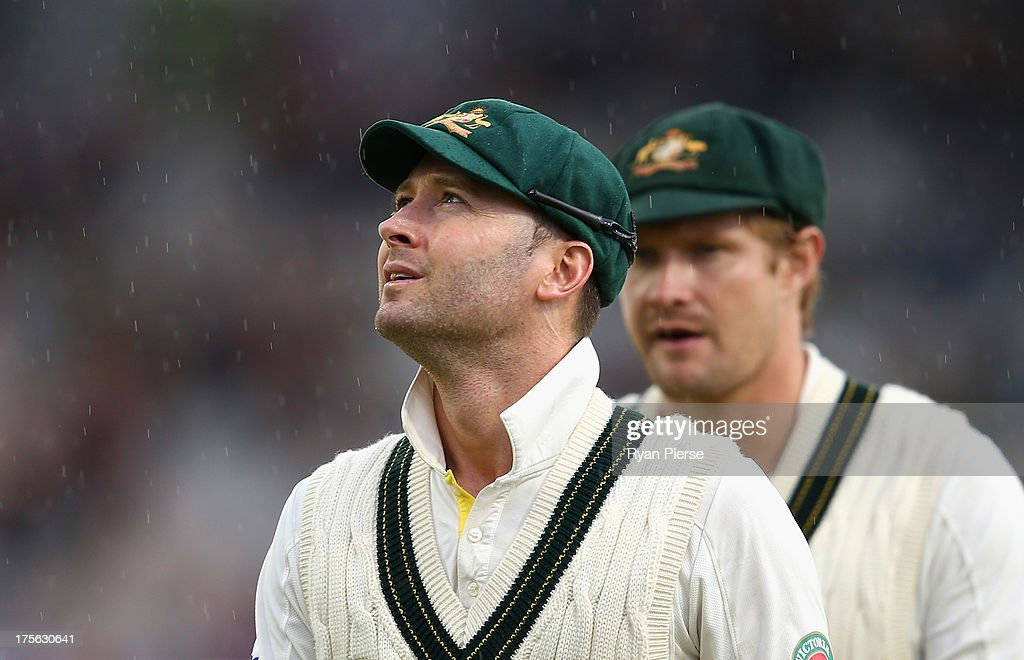 Michael Clarke and <a gi-track='captionPersonalityLinkClicked' href=/galleries/search?phrase=Shane+Watson+-+Cricket+Player&family=editorial&specificpeople=171874 ng-click='$event.stopPropagation()'>Shane Watson</a> of Australia leave the ground after rain stopped play during day five of the 3rd Investec Ashes Test match between England and Australia at Emirates Old Trafford Cricket Ground on August 5, 2013 in Manchester, England.
