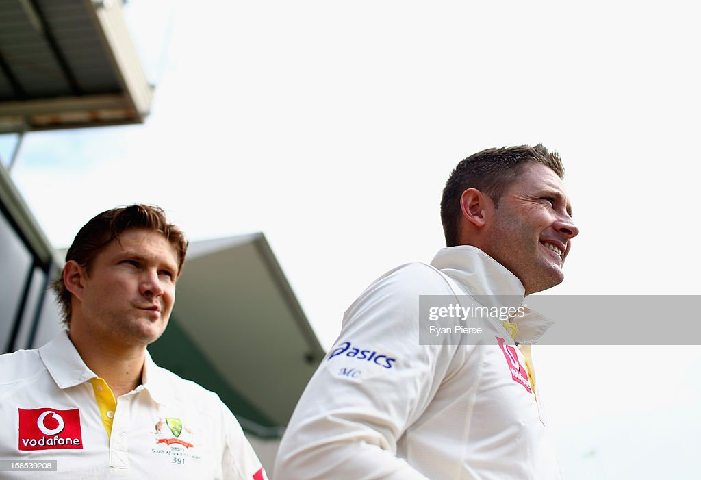 Michael Clarke and <a gi-track='captionPersonalityLinkClicked' href=/galleries/search?phrase=Shane+Watson+-+Cricket+Player&family=editorial&specificpeople=171874 ng-click='$event.stopPropagation()'>Shane Watson</a> of Australia walk out onto the field during day one of the First Test match between Australia and Sri Lanka at Blundstone Arena on December 14, 2012 in Hobart, Australia.