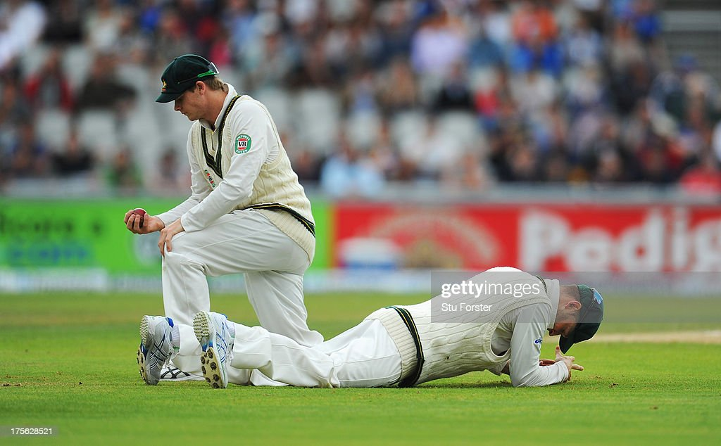Michael Clarke (R) and Steve Smith of Australia look dejected after failing to take a catch to dismiss Joe Root of England during day five of the 3rd Investec Ashes Test match between England and Australia at Emirates Old Trafford Cricket Ground on August 5, 2013 in Manchester, England.