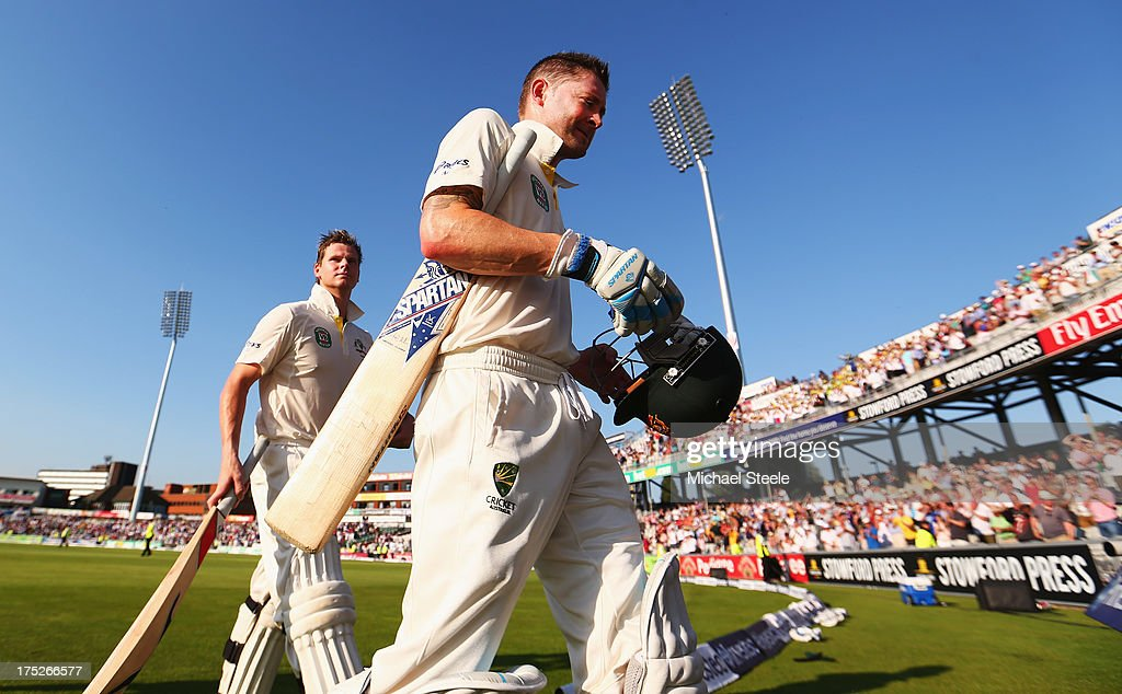 Michael Clarke (R) and Steve Smith of Australia walk off at the end of play during day one of the 3rd Investec Ashes Test match between England and Australia at Old Trafford Cricket Ground on August 1, 2013 in Manchester, England.