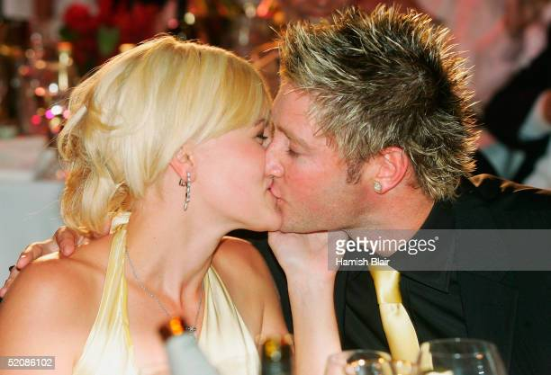 Michael Clarke gets a congratulatory kiss from Erina LeaConnelly after his win in the Allan Border Medal as the Cricketer of the Year for the 2005...