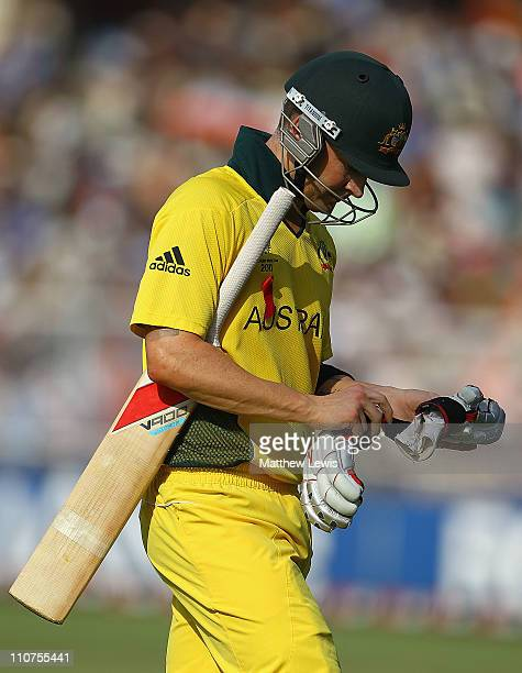 Michael Clarke of Australi walks off after he was caught by Zaheer Khan of India off the bowling of Yuvraj Singh during the 2011 ICC World Cup...