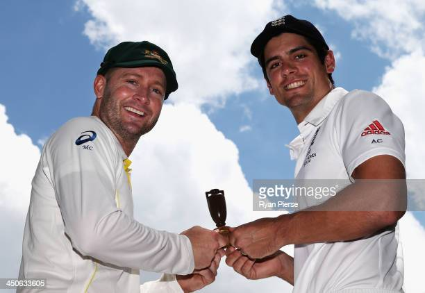 Michael Clarke of Australia and Alastair Cook of England hold a replica urn during an Ashes captain's photocall at The Gabba on November 20 2013 in...
