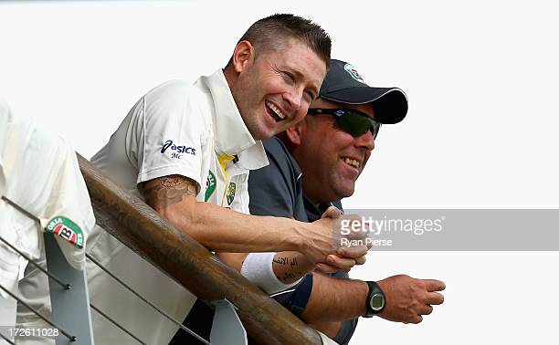 Michael Clarke of Australia and Darren Lehmann coach of Australia look on during day three of the Tour Match between Worcestershire and Australia at...