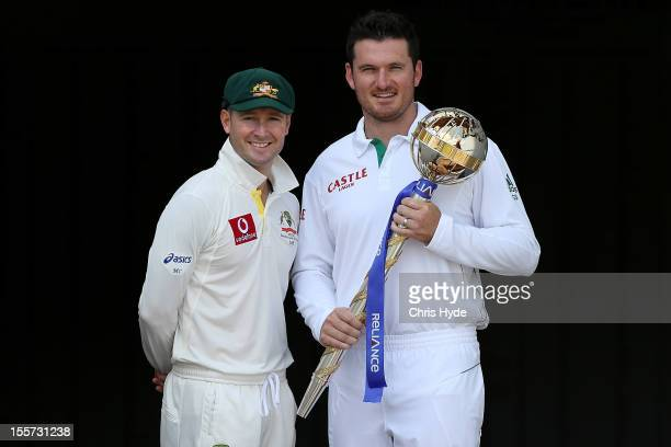 Michael Clarke of Australia and Graeme Smith of South Africa pose with the ICC Test Championship Mace during a captain's media call at The Gabba on...