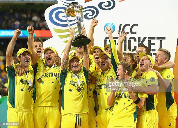 Michael Clarke of Australia and his team mates raise the trophy after winning the 2015 ICC Cricket World Cup final match between Australia and New...