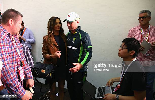 Michael Clarke of Australia and his wife Kyly Clarke leave a press conference after Clarke announced his retirement during day three of the 4th...