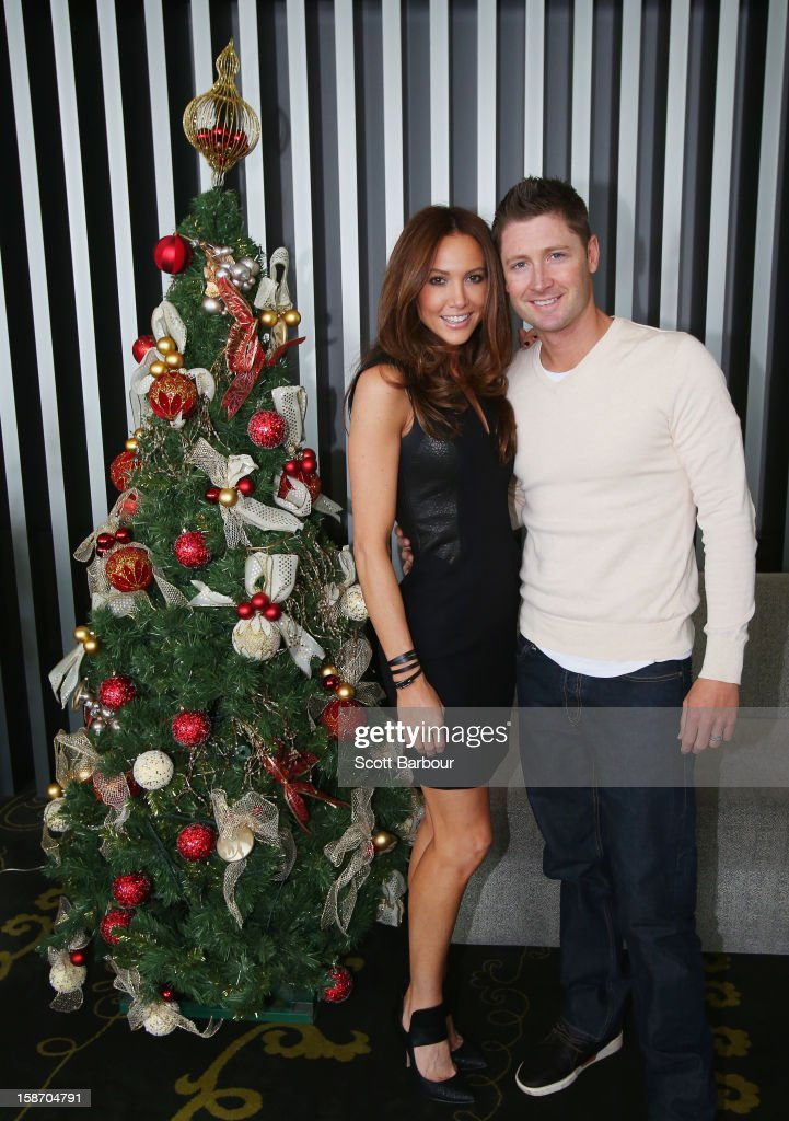 Michael Clarke of Australia and his wife Kyly Clarke pose next to a Christmas tree ahead of a Cricket Australia Christmas Day lunch at Crown Entertainment Complex on December 25, 2012 in Melbourne, Australia.