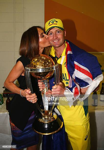 Michael Clarke of Australia and his wife Kyly Clarke pose with the trophy in the change rooms during the 2015 ICC Cricket World Cup final match...