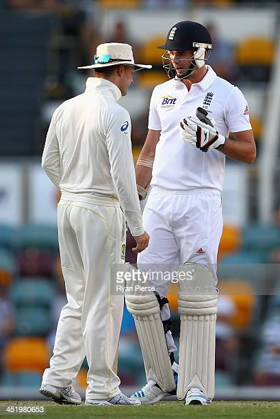 Michael Clarke of Australia and James Anderson of England exchange words during day four of the First Ashes Test match between Australia and England...