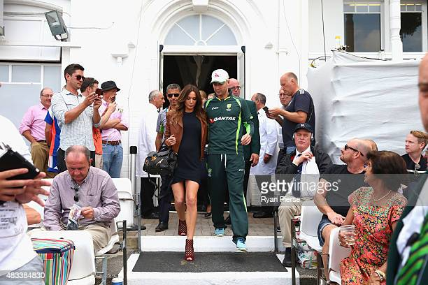 Michael Clarke of Australia and Kyly Clarke wife of Michael Clarke of Australia walk onto the field after Clarke announced his retirement during day...