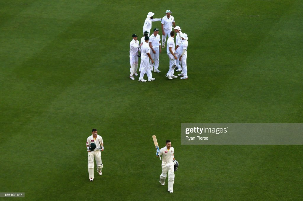Michael Clarke (R) of Australia and <a gi-track='captionPersonalityLinkClicked' href=/galleries/search?phrase=Michael+Hussey&family=editorial&specificpeople=171690 ng-click='$event.stopPropagation()'>Michael Hussey</a> (L) of Australia leave the ground at stumps during day four of the First Test match between Australia and South Africa at The Gabba on November 12, 2012 in Brisbane, Australia.