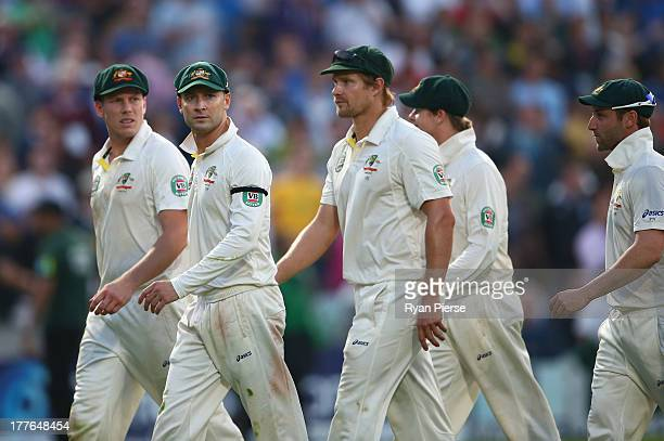 Michael Clarke of Australia and team mates leave the field after bad light ended the match during day five of the 5th Investec Ashes Test match...